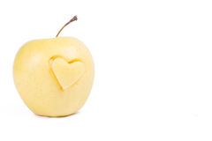 Apple with heart isolated on white Royalty Free Stock Photography