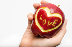 Apple,heart,love in woman hand isolate on white background Stock Photo