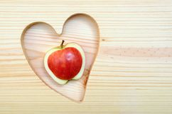 Apple and heart shape Stock Photography