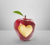 Apple with heart shape Stock Photography