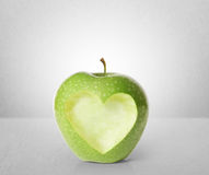 Apple with heart shape Stock Photo