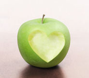 Apple with heart shape Royalty Free Stock Photography