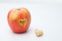 Apple with a heart shaped cut-out Royalty Free Stock Photography