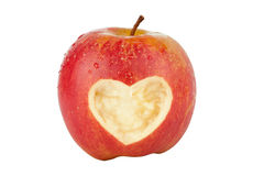 Apple with a heart symbol Royalty Free Stock Images