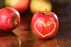 Apple heart on a wet table Royalty Free Stock Photos