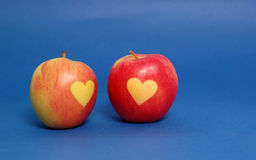 Apple hearts on blue background Stock Photography