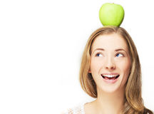 Apple on her head royalty free stock photos