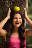 Apple on her head. Royalty Free Stock Photography