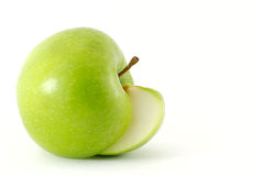 Apple and his slice. Isolated Royalty Free Stock Photography