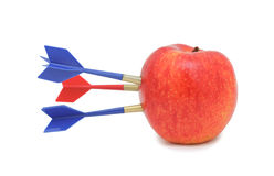 Apple hit by arrows, isolated Stock Images