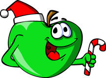 Apple holding a candy cane and wearing Santa's hat Royalty Free Stock Photography