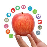 Apple holding in Hand with Health Icons Around.  Royalty Free Stock Photos