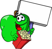 Apple holding popcorn and blank board Royalty Free Stock Photo