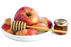 Apple and honey. Red apple, wooden spoon for honey and a jar with honey Stock Image