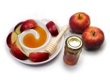 Apple and honey. Apple in the socket and honey on a white background Royalty Free Stock Image