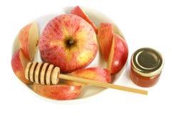 Apple, honey and honey spoon Royalty Free Stock Photos