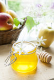 Apple and honey on light wooden table Stock Photo