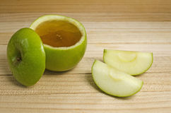 Apple in honey for Rosh Hashanah Royalty Free Stock Images