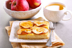 Apple and honey topping cheesecake. Slice on plate Royalty Free Stock Photos