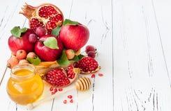 Apple and honey, traditional food of jewish New Year - Rosh Hashana. Copy space background. Apple and honey, traditional food of jewish New Year - Rosh Hashana Royalty Free Stock Image