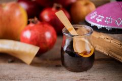 Apple and honey, traditional food of jewish New Year Rosh Hashana torah book, kippah yamolka talit. Apple and honey, traditional food of jewish New Year Rosh stock photo