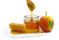 Apple and honey are traditional food for Rosh Hashanah - Jewish New Year Royalty Free Stock Photo