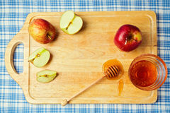 Apple and honey on wooden board. Jewish Rosh hashana (New Year) holiday celebration. View from above Royalty Free Stock Images
