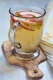 Apple hot tea. With thyme in glass mug Stock Photos