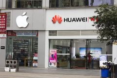 Apple and huawei. Apple brand stores are adjacent to HUAWEI brand stores. Metaphor: the competition of international brands and the game between big powers. The stock images