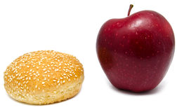 Apple and humburger on white Stock Photos