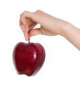 Apple i en hand Arkivbilder