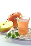 Apple iced tea. With fresh apples and ice cubes royalty free stock photography