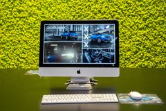 Apple iMac. BRUSSELS - JAN 10, 2018: Apple iMac with information about the new Opel Grandland X car shown at the Brussels Motor Show Stock Photos