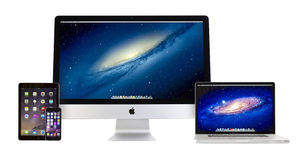 Apple iMac 27 inch, Macbook Pro, iPad Air 2 and iPhone 6. Apple iMac 27 inch desktop computer, Macbook Pro, iPad Air 2 and iPhone 6 on white background. All Stock Photography