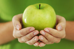 Apple In Woman Hands Royalty Free Stock Photo