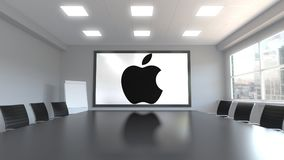 Apple Inc. logo on the screen in a meeting room. Editorial 3D rendering. Apple Inc. logo on the screen in a meeting room. Editorial 3D Royalty Free Stock Image