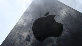 Apple Inc. logo on a skyscraper facade reflecting clouds, time lapse. Editorial 3D rendering. Apple Inc. logo on a skyscraper facade reflecting clouds, time stock footage