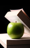 Apple inside a book Stock Photo