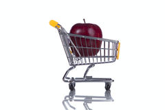 Apple inside a shopping cart Stock Photo
