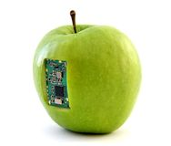 Apple with an integrated circuit Stock Photos