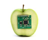 Apple with an integrated circuit Royalty Free Stock Images