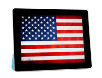 Apple Ipad 2 with American Flag on Screen. Apple iPad 2 with folded Smart cover, isolated on white background. American flag on screen Stock Images