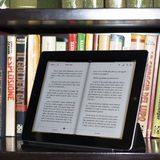 Apple ipad 2 in a modern library Royalty Free Stock Images