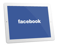 Apple iPad 4. White Apple iPad 4 With Facebook Displayed On The Screen Royalty Free Stock Photography