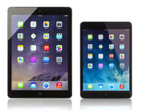Apple iPad Air and iPad Mini displaying homescreen Stock Photography