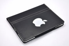 Apple Ipad com tampa de couro imagem de stock royalty free