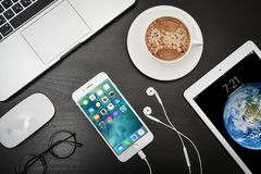 Apple iPad Gold with iPhone 8 plus and MacBook Pro. Kyiv, Ukraine - Fabruary 6, 2018: Apple iPad Gold with iPhone 8 plus and MacBook Pro on black wooden Stock Photography