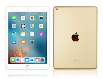 Apple iPad Gold. Kyiv, Ukraine - Fabruary 6, 2018: Brand new white Apple iPad Gold isolated on white with clipping path, 7th generation of the iPad, developed by Stock Photos