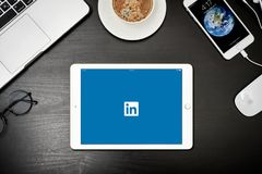 Apple iPad Gold with with Linkedin app on the screen. Kyiv, Ukraine - Fabruary 6, 2018: Apple iPad Gold with Linkedin app on the screen on black desk with Royalty Free Stock Photography