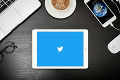 Apple iPad Gold with with Twitter app on the screen. Kyiv, Ukraine - Fabruary 6, 2018: Apple iPad Gold  with Twitter app on the screen on black desk, top view Royalty Free Stock Images